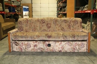 USED RV PINK CLOTH FLORAL SLEEPER SOFA W/ UNDERNEATH STORAGE